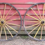 Two Early Painted Wood and Metal Wagon or Fire Engine Wheels